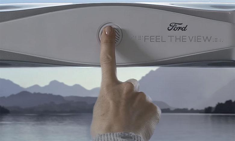 Nommé «Feel The View», le dispositif est composé d'un boitier intégrant une caméra et d'une surface tactile transparente,  fixés sur la vitre du véhicule.