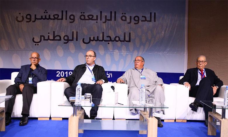 Hakim Benchemach et Ahmed Akhchichine (au centre) lors de la 24e session du conseil national,  le 5 mai dernier à Rabat.